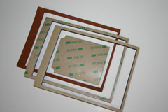 Acrylic adhesive-backed silicone gaskets