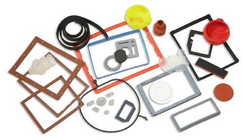 Silicone sponge gaskets, molded silicone rubber components, and molded fluoropolymer chamber gaskets