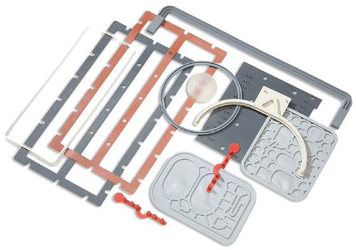 Ribbed silicone sealing gaskets, silicone plenum gaskets, and silicone sealing gaskets with flexing membranes.