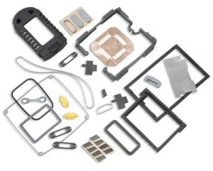 Portable device gaskets assortment: molded silicone shroud, silicone connector gasket, and molded silicone shock absorber for display on a portable data acquisition device